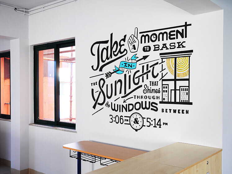 Typography mural art in office bt Decotarium